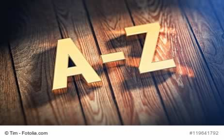 "The sign ""A-Z"" is lined with gold letters on wooden planks. 3D illustration image"