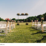 Wedding altar made of wooden sticks and bouquets stands before t