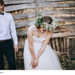 charming bride and groom in hayloft at summer day