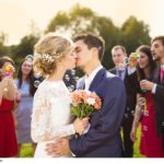 newlyweds-kissing-at-wedding-reception-halfpoint-2